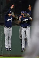 Aug 22, 2017; San Francisco, CA, USA; Milwaukee Brewers outfielders Ryan Braun (8) , Hernan Perez (14) and Keon Broxton (23) celebrate their 4-3 win over the San Francisco Giants at AT&T Park. Mandatory Credit: Lance Iversen-USA TODAY Sports