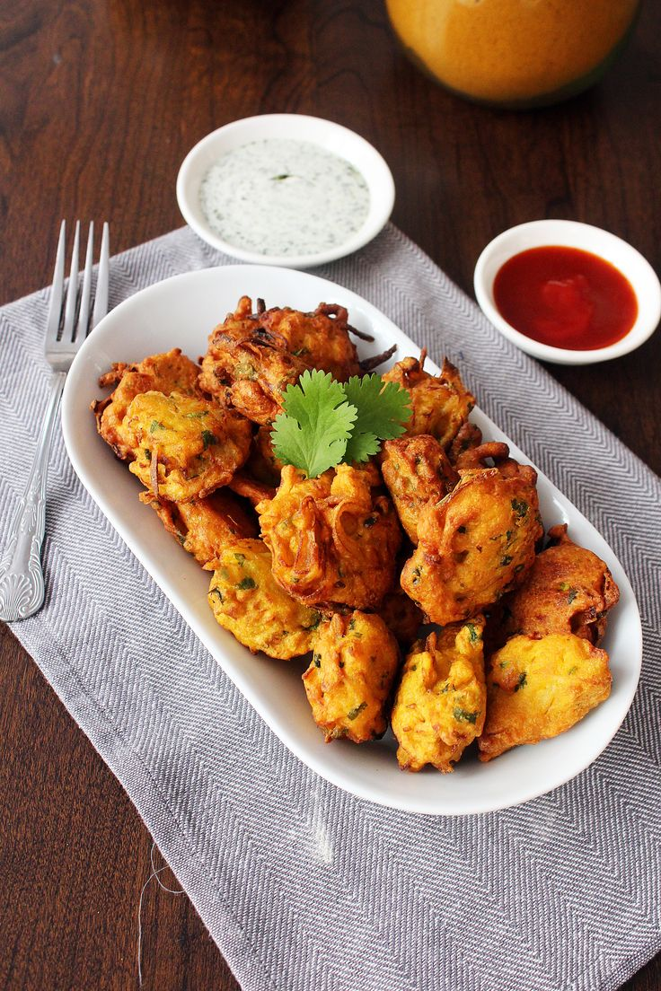 Pakoras – Indian Fritters. These crispy, golden potato and onion bites uses simple ingredients to serve as a delicious snack or appetizer. From Something Tasty.