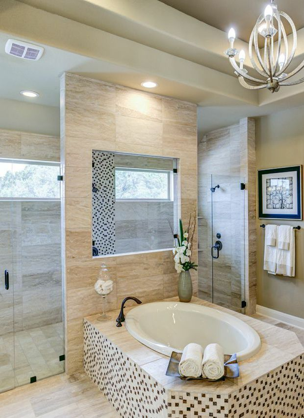 bring a light atmosphere into your master bathroom with a expansive glass shower overlooking your backyard