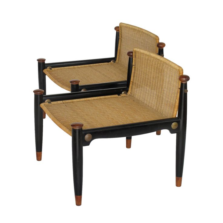 A pair of low back decorative wicker chairs by frank kyle