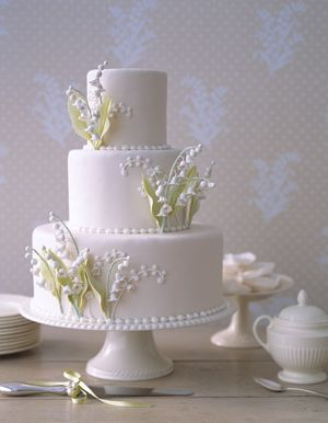 Elegant wedding cake with lilies of the valley