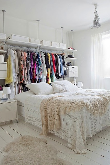 "great idea for a closet downstairs. hang curtains to hide clothes. leave room behind to walk around and get to clothes. kind of like a makeshift ""walk in"" closet area."