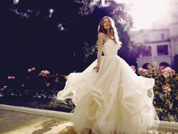 """The """"Magnolia"""" wedding gown from Lauren Elaine Bridal.   Couture Bridal by Celebrity Designer Lauren Elaine.   Life is a story. Make yours a fairytale in the blossoming tulle and Point D'Esprit backless """"Magnolia"""" dress. Featuring a decadent layered twirl-worthy skirt with ruched sweetheart bodice and Point D'Esprit horsehair hemmed petals. Enchantingly made in Los Angeles, CA. #laurenelainebridal"""