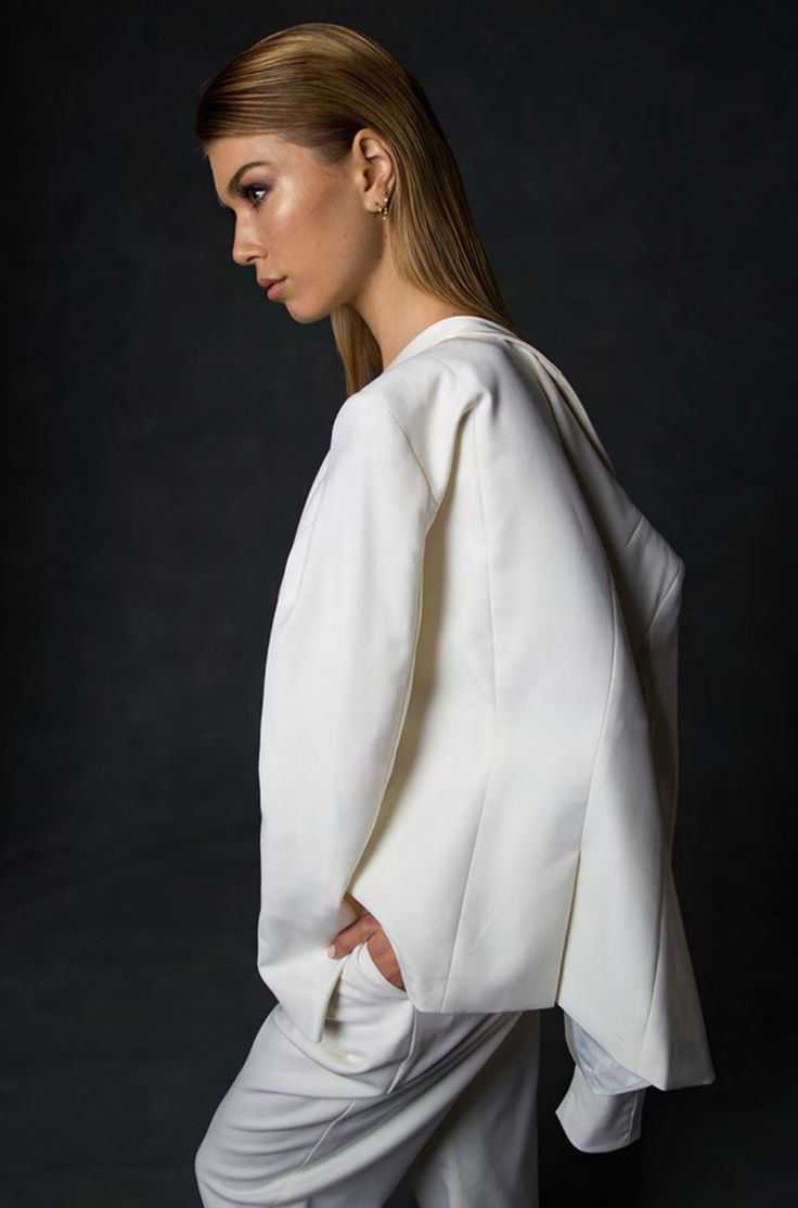 Women's ivory suit with notched lapel.