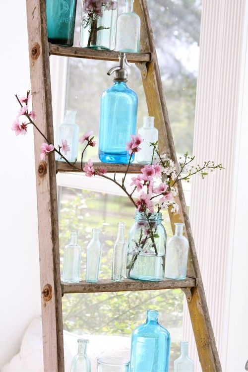 Ladders, ladders, ladders! I want a ladder for the stage. A plain old wooden one. I want to put glass vases or jars on it, and some flowers like this. But I want the jars and the flowers to glow.