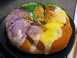 A king cake (sometimes rendered as kingcake, kings' cake, king's cake, or three kings cake) is a type of cake associated with the festival of Epiphany in the Christmas season in a number of countries, and in other places with the pre-Lenten celebrations of Mardi Gras / Carnival.