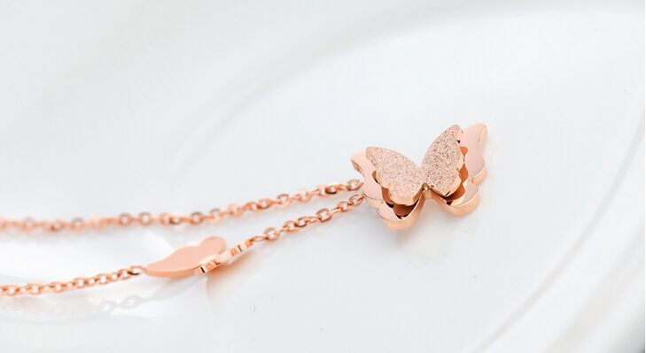 18K rose gold plated necklace with butterflies.