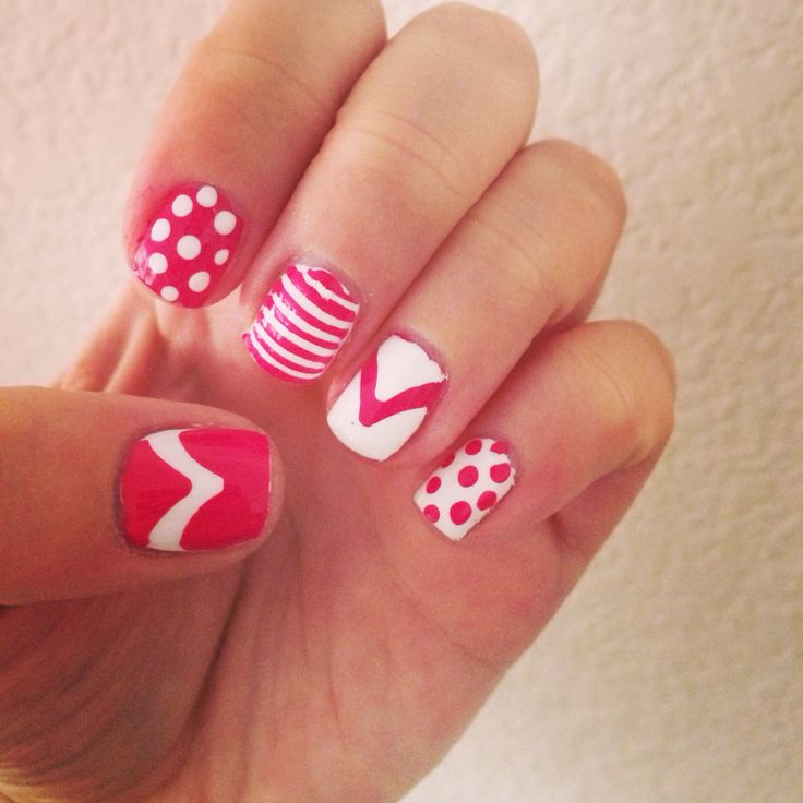 Pink and white nails with polka dots and chevon designs