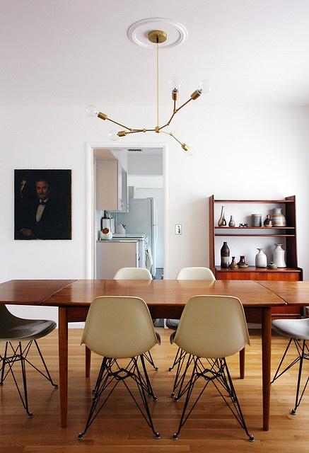 Eames chairs, teak table, vintage pottery collection, portrait art and DIY light fixture