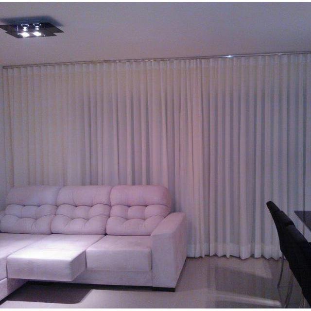 Deixe sua sala mais leve e elegante com um toquede voilem uma CortinaFranzida.