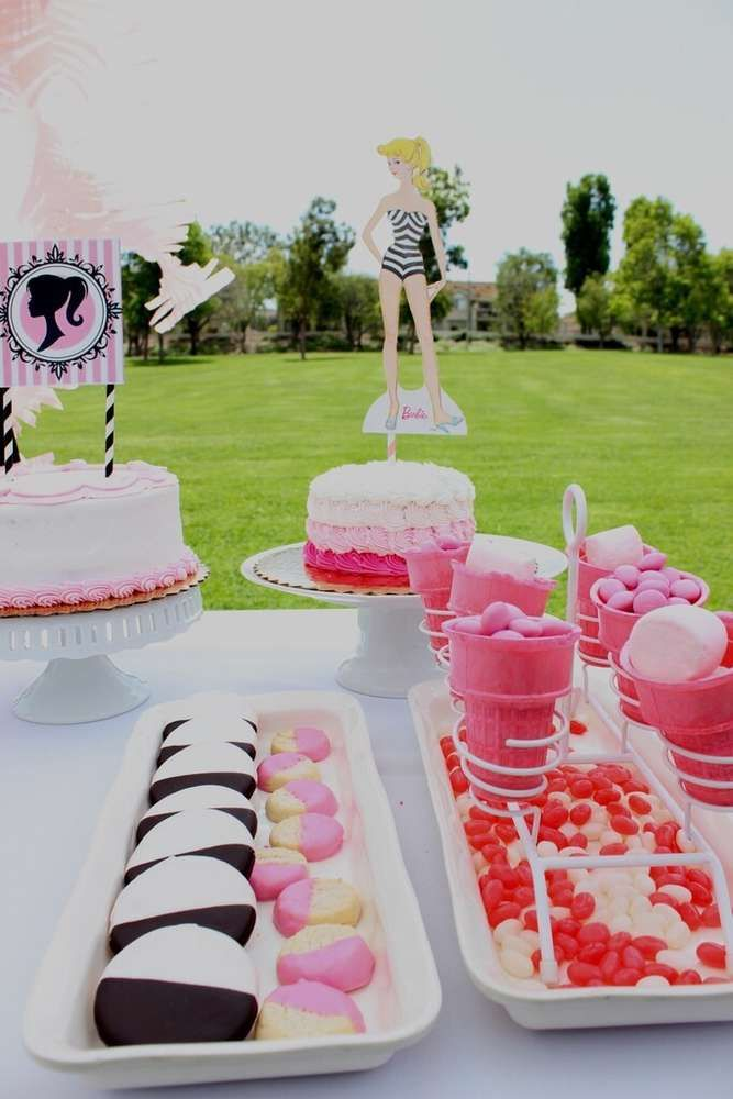 Pretty cake and treats at a Barbie birthday party! See more party planning ideas at CatchMyParty.com!