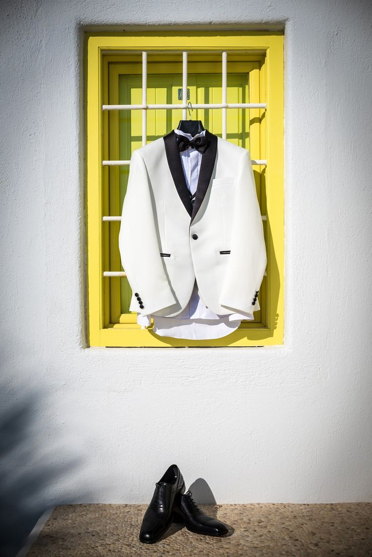 It is a man's world!! #groom #preparation #tuxedo #shoes #white #classic #bow #style #santorini #villa #yellow #window #colorful #wedding #planner