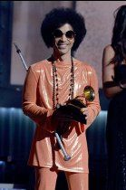 Prince presents the award for album of the year at the Grammy Awards.