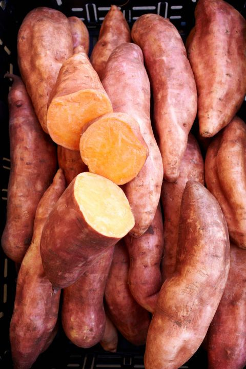 Keep a couple of these orange root vegetables in your pantry for when you want to satisfy your carb craving and sweet tooth (okay—so it's no candy bar, but c'mon). A medium-size sweet potato contains about 27 grams of carbs, but they've been shown to increase levels of adiponectin, a hormone that regulates blood sugar, and in turn helps encourage a faster metabolism. They're also fat-free and have fewer calories and sodium than white potatoes.