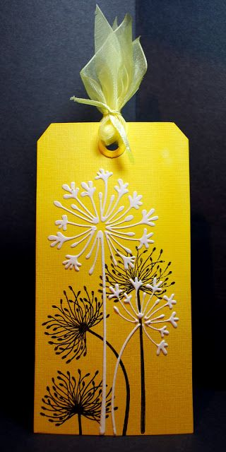 stunning yellow tag - ombre inking background with dandilions in sold back  stamping  with white agapanthas stenciled on top with White Glossy embossing paste