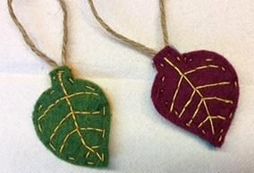 2 felt leaves, made by Gréta & Fruzsi. Side 1