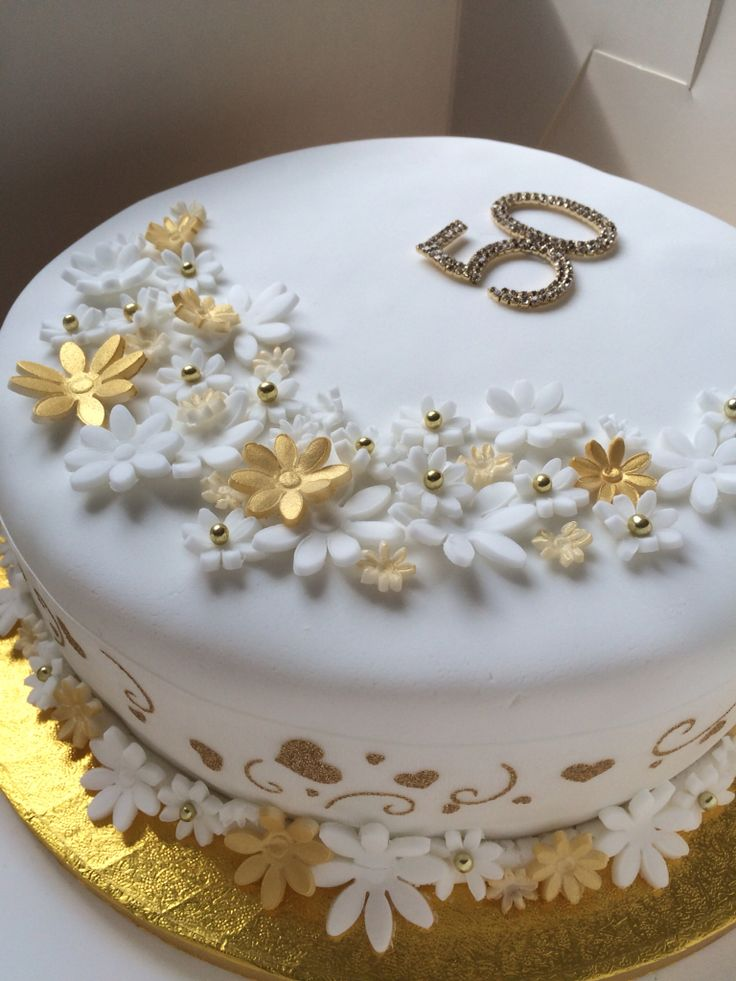 Golden Wedding Anniversary Cake. 50 years of marriage celebration fruit cake.