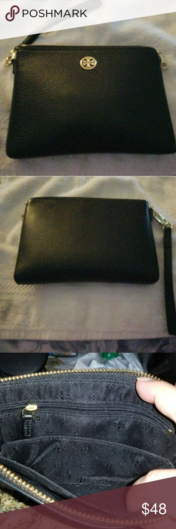 """Tory Burch WRISTLET Soft pebbled leather,  Gold hardware, Gold TB logo Zip closure, detachable 8"""" leather strap with gold snap hook. Tory Burch signature lining, 1 interior zip pocket , 2 slip pockets It can also fit a Samsung S8 phone! #Please note one corner is slighlty rubbed off.   Measures: 8""""L x 5.5""""H x 1"""" D Retail price: $165 Tag included. Make an offer!! Tory Burch Bags Wallets"""