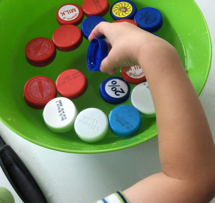 Floating matching game -- match milk caps with numbers, symbols, and words.  Also, this is a great sensory activity.  (Number matching and recognition)