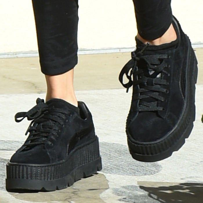 06eddc10f6e Selena switches to her Puma x Fenty by Rihanna creeper sneakers ...