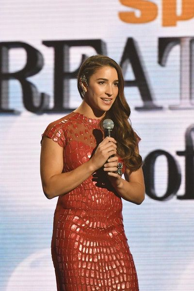 Aly Raisman Photos Photos - Olympic Gymnast Aly Raisman speaks onstage during the Sports Illustrated Sportsperson of the Year Ceremony 2016 at Barclays Center of Brooklyn on December 12, 2016 in New York City. - Sports Illustrated Sportsperson of the Year Ceremony 2016