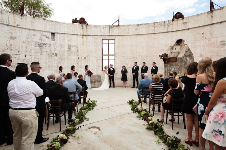 Wedding ceremony in the Yale Columbia Dome ruins at Mt Stromlo, Canberra. Flowers by Barton Flower Bar.