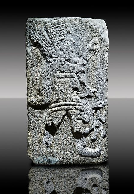Picture & image of a Neo-Hittite orthostat with a releif sculpture of A Winged God from Aslantepe , Malatya - Turkey. The God holds a branch of fruit in his left hand and a single fruit in the right hand. | © Paul E Williams 2013