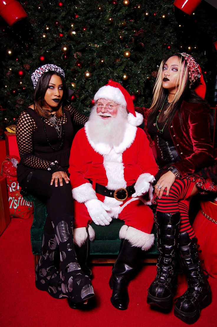 "I never get tired of ""goths with Santa"" photos"