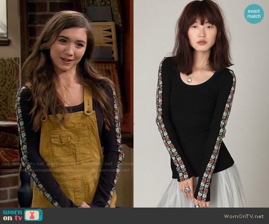 Riley's yellow overalls and black top with floral embroidered sleeves on Girl Meets World.  Outfit Details: https://wornontv.net/55759/ #GirlMeetsWorld