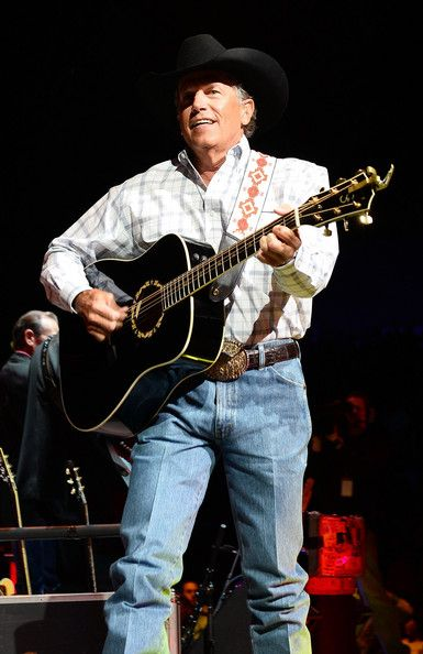 George Strait Photos Photos - Recording artist George Strait performs during The Cowboy Rides Away Tour at the MGM Grand Garden Arena on February 1, 2014 in Las Vegas, Nevada. - George Strait In Concert At The MGM Grand In Las Vegas