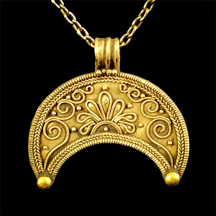 Greek Hellenistic Lunar gold pendant form of a wide moon crescent with granules the crescent surrounded by spirals, filigree around the perimeter a small sphere at each base.