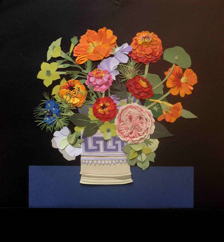 gorgeous cut-paper flower bouquet. The flowers have so many layers...