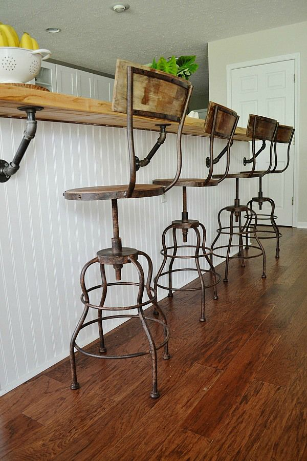 How about these industrial-style chairs and steam-punk breakfast-bar supports? Via Lizmarieblog.com