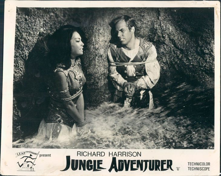 JUNGLE ADVENTURER RICHARD HARRISON AND GIRL TIED UP AGAINST CAVE WALL LOBBY CARD