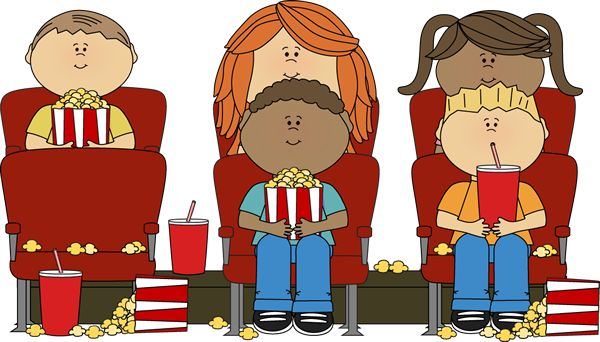 Kids watching a movie in a movie theater.