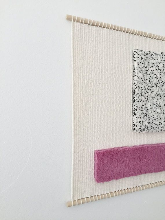 This woven piece was exhibited in Ottawa, Ontario at the Ottawa Art Gallery annex in City Hall from September 2016-January 2017. It was made with a natural, un-dyed cream cotton, and black and magenta wool fibres. It measures roughly 20 inches x 20 inches. Genuine leather artist tag sewn on