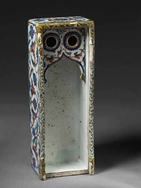 Writing box Place of origin: Iznik, Turkey (probably, made) Turkey (made) Date: ca. 1585-90 (made) Physical description Writing box (pencase), fritware, oblong, with two receptacles for writing fluid, and grooves for a sliding lid; decorated with floral ornament in thick red, blue and green.