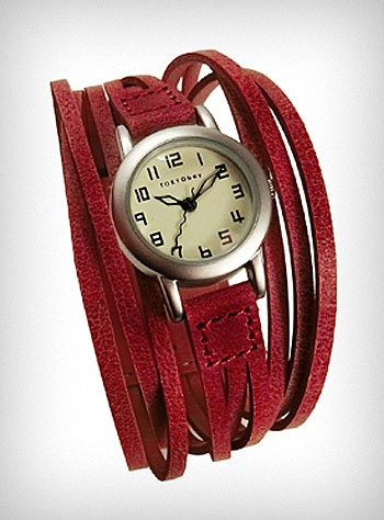 Red String Theory Wrist Watch: - Recieved this as a holiday gift. Good quality leather. Watch face is lovely and easy to read. Clasp is a peg-and-hole type but is incredibly secure. Weak point of the watch seems to be the small bit of metal that attaches the strap to the face. Easily fixed if, say, torn off with a backpack.
