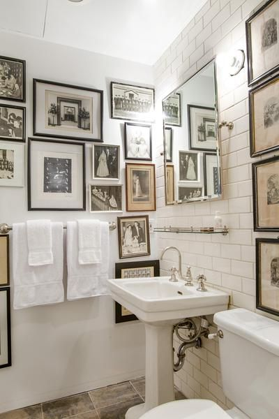 Bathroom walls covered in black and white art.