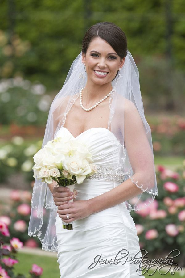 Bridal portraits in white gown with white bouquet, photographed by Knoxville wedding photographer Jewels Photography