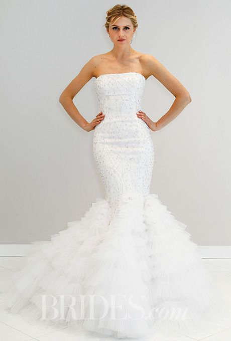 A form-fitting, strapless @randirahm wedding dress with a trumpet hem  | Brides.com