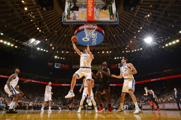 Zaza Pachulia of the Golden State Warriors grabs the rebound against the Chicago Bulls on November 24 2017 at ORACLE Arena in Oakland California NOTE...