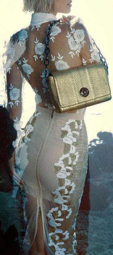 Blumarine. Madam! A bra or corset top underneath please! This top is so pretty.