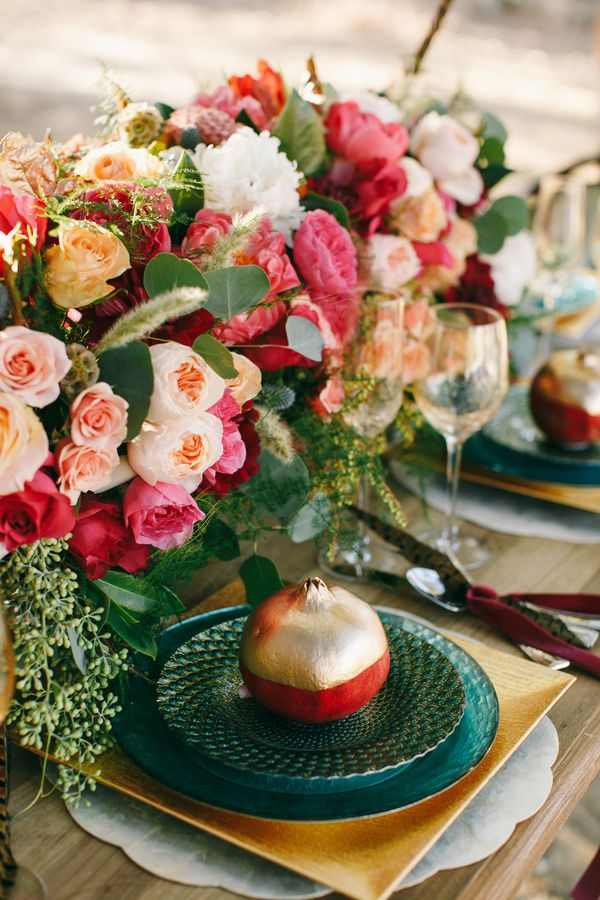 pomegranate place setting, photo by Photography by Charise http://ruffledblog.com/a-late-fall-inspiration-shoot-in-california #gold #weddingideas