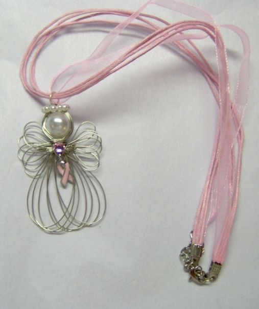 """Silvertone Wire Angel is 2 inches and strung on a 16 1/2"""" Pink Ribbon Necklace Cord that has a 2"""" extension chain  It has a Large Ring attached to the pendant so you may remove and place on another chain you have if you like..."""