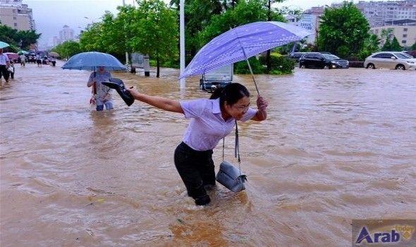 Typhoon Megi brings downpours, flooding roads in…