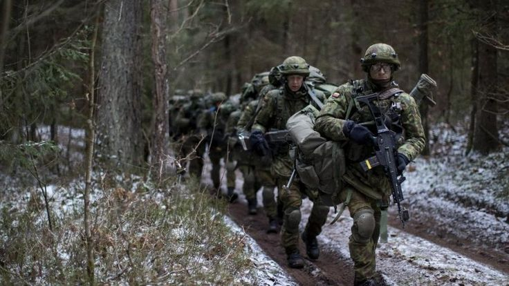 Lithuanian conscripts practice during a NATO military exercise, 'Iron Sword,' at the Rukla military base some 130 km. (80 miles) west of the capital Vilnius, Lithuania, Monday, Nov. 28, 2016. Across the Baltic states of Lithuania, Latvia and Estonia some people fear that Russia, after military interventions over the past years in Georgia, Ukraine and Syria, could turn to them next. (AP Photo/Mindaugas Kulbis)