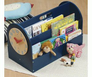 Childrens book storage. This looks like a cute portable idea for smaller books. I like the clock too!