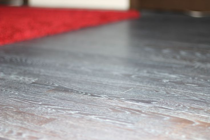 Grain popping effect with Loba's Impact oil. Ebony aniline dye was applied and then 2 coats of Loba's impact color - white was applied to bring out the grain of the oak wood flooring.
