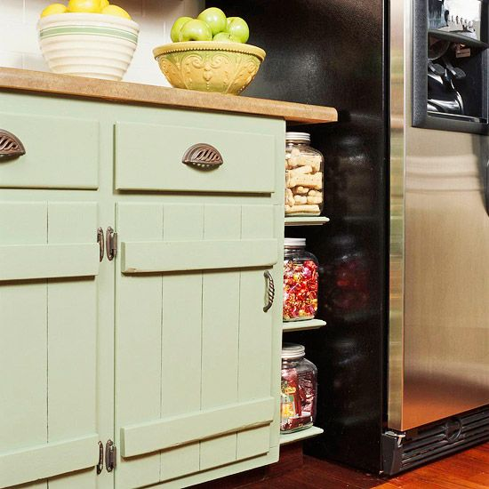 Feeling Groovy  Vertical grooves and horizontal supports create texture that adds interest to basic doors. Soft green paint, a butcher-block countertop, and new hardware, including bin pulls in a weathered iron finish, continue the rustic look